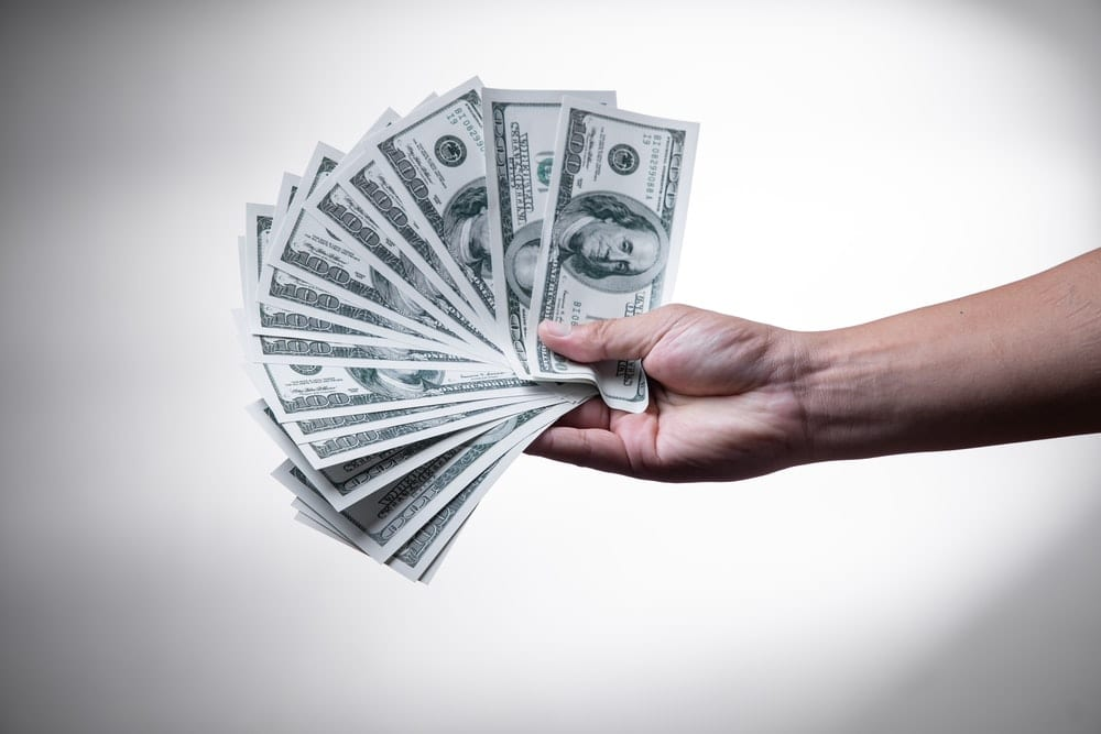 person holding cash