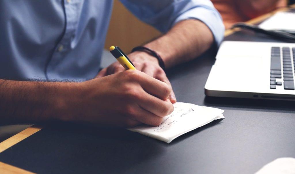 A person writing a list.
