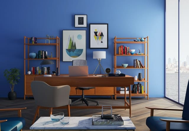 a home office painted in blue