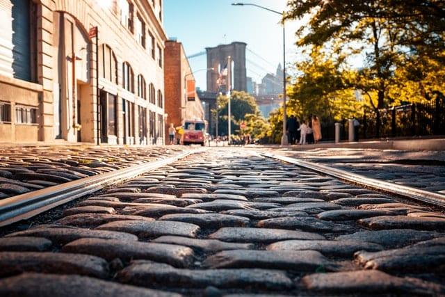 A street in NYC overlooking the Brooklyn Bridge.