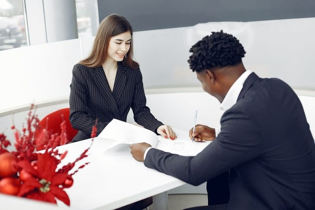 An agent and a client signing papers